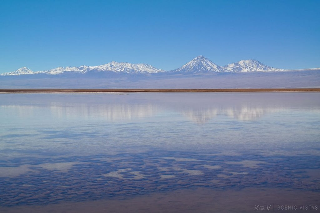 Colorful mountain reflection in the salt flats of Laguna Tebenquiche.