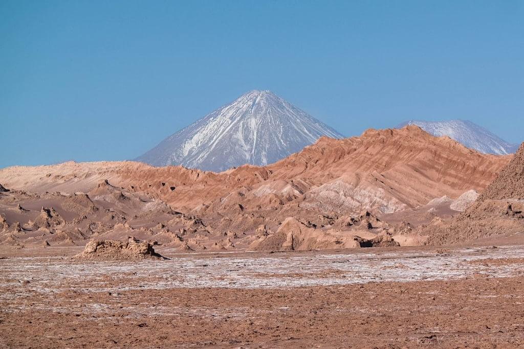 Volcan Licancabur behind the landscape of the Cordillera de la Sal.