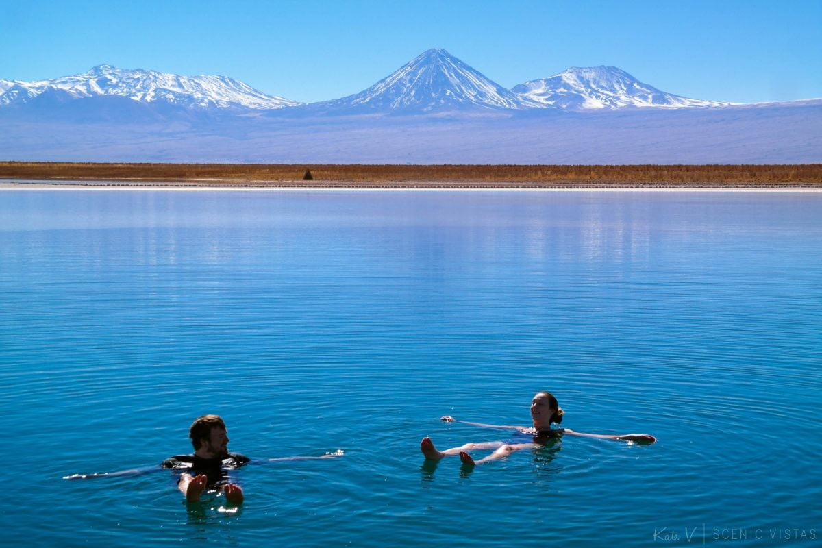 Couple floating together in the salty Laguna Cejar in the Atacama Desert.
