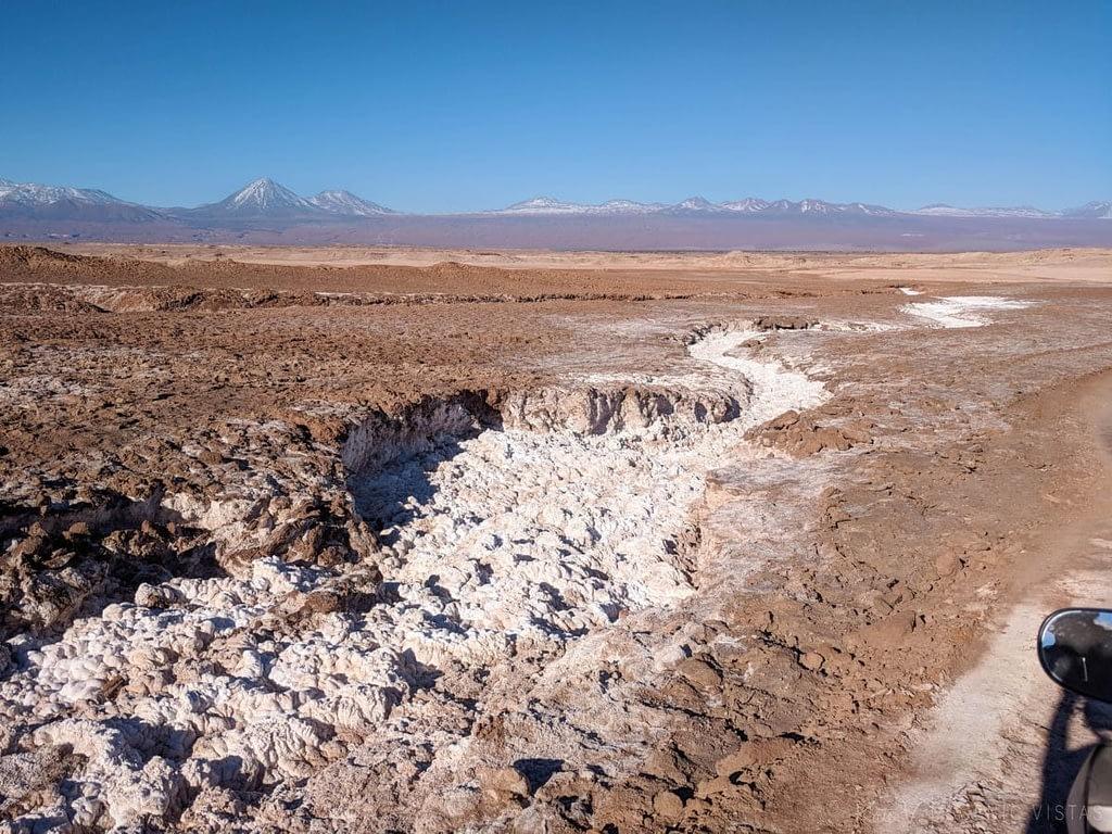 A salt river stands out against the colorful Atacama Desert.