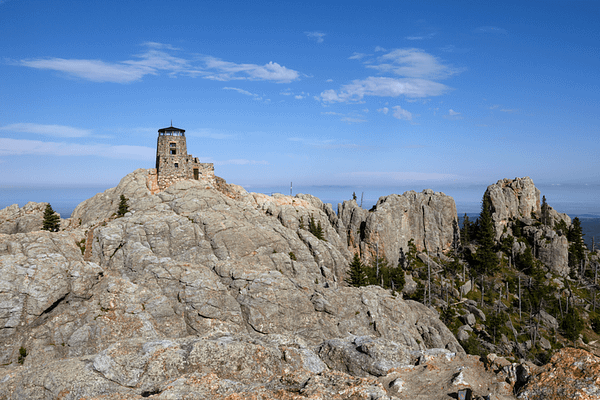 Looking back at the Harney Peak Lookout tower and surrounding spires from the rocks nearby