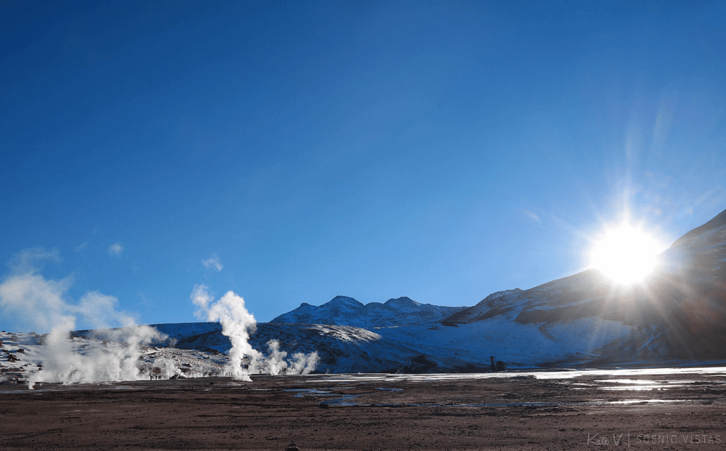 Steam rising from the Tatio Geysers in front of the mountains.