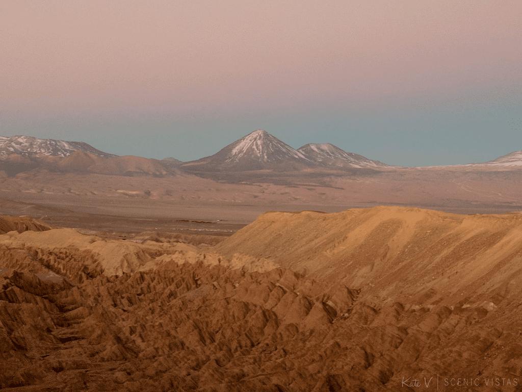 Red sunset over Volcan Licancabur behind the Valle de la Luna in the Atacama Desert.