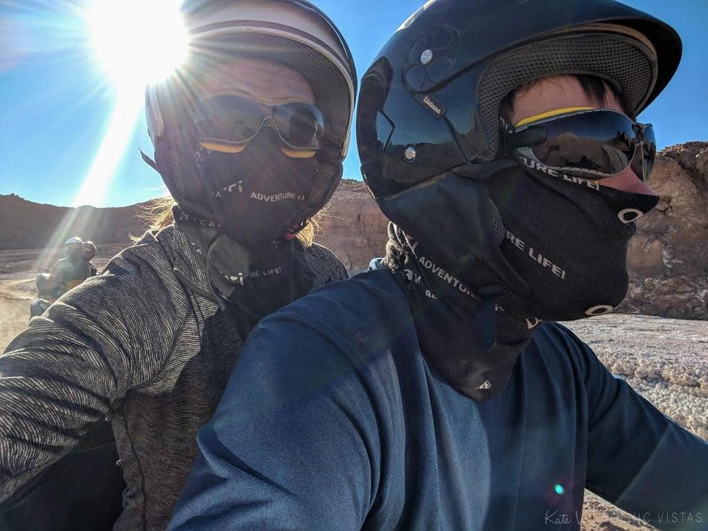 Couple riding an ATV.